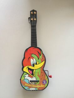 Woody Woodpecker Mattel Toy Guitar Vintage 1963 - we had one, but I can't remember if it was a Woody Woodpecker one or not.