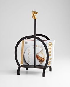 """Equestrian Magazine Rack design by Cyan Design - 12""""(w) x 23""""(h) - Black and Gold Cyan Design makes fabulous home décor items that not only help you create a warm and inviting space, but also one of f"""