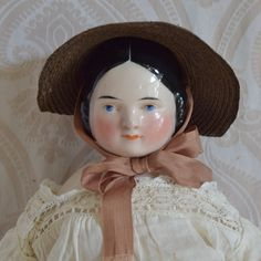 Covered Wagon Glazed Porcelain German China Head Doll by Kister.