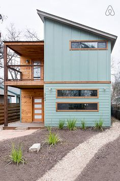 ***Exterior color, wood color, may be too trendy*** We teamed up with H&M and Airbnb to design a beautiful, comfortable and perfectly located home for six lucky SXSW-bound winners. Modern Exterior, Exterior Colors, Exterior Design, Interior And Exterior, Diy Exterior, Roof Design, Window Design, Casas Containers, Austin Homes