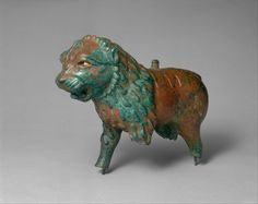 Figure of a lion  Period:Iron Age Date:ca. early to mid-1st millennium B.C. Geography:Anatolia or Syria Medium:Copper alloy Dimensions:H. 7-3/8 in. (18.7 cm) x L. 10-1/2 in. (26.7 cm)