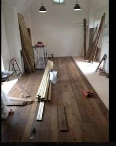 IMAGE ONLY - Converted Shed - installing hardwood floors in the weekend get-away...hmmmm <3 it!