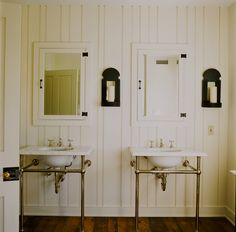 This master bath stays in keeping architecturally in this PA farmhouse.  Free standing, sinks with their own mirrors and medicine cabinets provide plenty of storage and space.  The light fixtures and door hardware accent the period look.