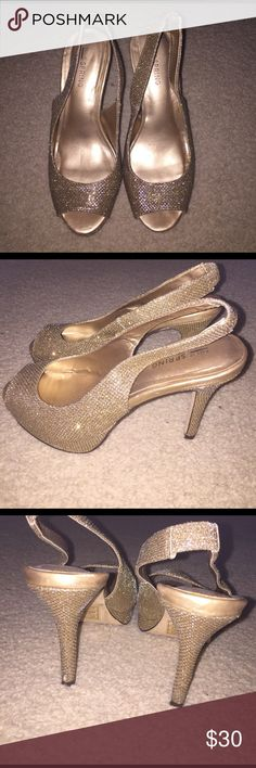 Gold Sparkly Prom Shoes Worn one day for prom. The back of the left heel is a little bit scraped as you can tell by the picture but besides that they're fine. Surprisingly they were very comfortable and I didn't have to take them off at any point of the day. Call It Spring Shoes Heels