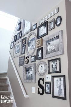 Great idea for telling your family story in a photo gallery wall collection going up the stairs.