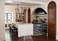 It's all in the details for this kitchen, highlighted with a beautiful hutch, handsome handles on the stove, and an island topped with marble.