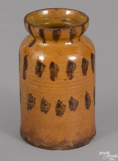 Pennsylvania redware jar, 19th c., with rows of manganese splotches on an orange ground, 6 1/2'' h. - Price Estimate: $300 - $400