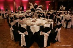 Minus the feathers in the middle. Then with red roses and the girls in red, too... White table, black chair, white sash