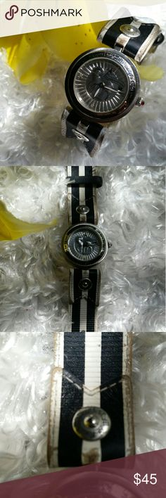 LAMB watch *SOLD* *Beautiful LAMB silver, black, and white watch *As shown in pictures has been very loved, crystal face without scratches and red crystal still attached to dial *Wear is mainly on the band; genuine leather  *Currently no working battery but will put one in before sending out *Sorry no trades or Mericari accepted thx LAMB  Jewelry