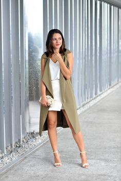 Jessica Camerata of @mystylevita in a duster and white mini skirt