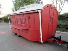 """This bright red """"vardo"""" is just one of the numerous tiny houses (many on trailers, as this one is) offered at the Tiny House Listings website. A good way to really get a picture of what people are doing in this field is to right click the images which appear on individual listings and then download the images to a particular folder on your hard drive. (I like to open these images in Paint and then add my own comments about noteworthy aspects of particular designs.)"""