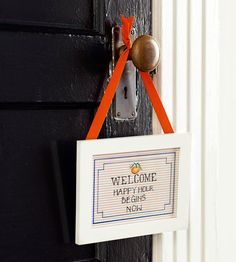 Welcome guests with an inexpensive DIY door hanger. See the rest of this party: http://www.bhg.com/party/birthday/themes/host-a-summer-party-on-a-budget/?socsrc=bhgpin041713DIYdoorwelcome=3