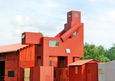 atelier van lieshout sculpts dark and humorous art village for ruhrtriennale festival