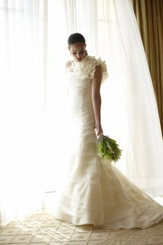The bride looked stunning in a tiered, one-shoulder Vera Wang bridal gown. She wore her hair back in a pony tail and carried a lily of the valley bouquet. Photography: Dalal Photography.  Read More: http://www.insideweddings.com/weddings/lavish-white-wedding-at-the-four-seasons-hotel-in-beverly-hills/307/