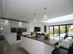 Large #handleless kitchen by @kitchenerg in a mix of Remo Dove Grey and Gloss White colours- http://www.sncollection.co.uk/real-kitchens/real-kitchen-projects/remo-dove-grey-kitchen-ergonomics.html