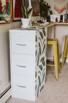 don't like this pattern, but I like the idea of paint + contact paper hacks to dress up an old filing cabinet