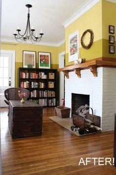 Beautiful transformation of an otherwise icky space. I like the top yellow and the fireplace and the book cases!