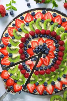 This BEST fruit pizza is made with a soft sugar cookie crust cream cheese frosting and loaded with fresh vibrant fruit. Its the perfect summer dessert. Soft Sugar Cookies, Sugar Cookie Dough, Cookie Crust, Sugar Cookies Recipe, Sugar Cookie Fruit Pizza, Pizza Cookies, Pizza Dessert, Fruit Pizza Bar, Sweets