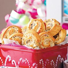 Crab 'n' Cheese Spirals Recipe -These pretty pinwheels are loaded with cheese, imitation crabmeat and black olives. Using refrigerated crescent rolls is so convenient.—Lisa Harke, Old Monroe, Missouri