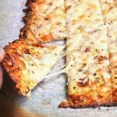 Cauliflower Breadsticks...11/23/13, this is in oven right now...looks yummy. Can't wait to taste this. The entire cookie sheet is 271 calories! Definitely a good low carb, healthy, low calorie snack. Dip into some low-sodium marinara! Add more spices next time, oregano?, to give even more flavor..