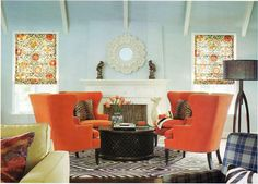 Blue room- white trim-orange chairs-leopard pillows-great rug and coffee table....