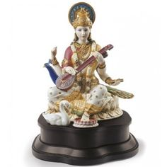 Sculpture of the Hindu goddess Saraswati in a combination of matte white porcelain and gold lustre. Saraswati Statue, Saraswati Goddess, Krishna Statue, Hare Krishna, Hindus, Ganpati Bappa Wallpapers, Indian Goddess, Lord Vishnu Wallpapers, Stone Sculpture
