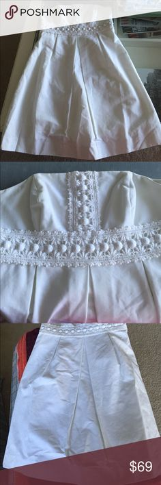 Lilly Pulitzer white cotton beaded strapless dress Beautiful Lilly Pulitzer white cotton beaded dress with build in stays to keep everything nicely in place. Perfect for the season. Lilly Pulitzer Dresses Strapless