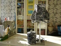 A lampshade made of textile yarn.