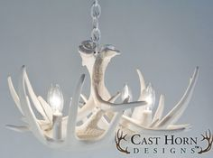 The Whitetail Deer 6 Antler Chandelier in Pure White from Cast Horn Designs is very compact to create special lighting in small spaces. This antler chandelier is a great choice for a filler for smaller areas that need that special highlight. It is only has four 25-watt candle lights and weighs approximately 8 pounds. When looking for a way to light those small, deep corners, this chandelier is the perfect choice.