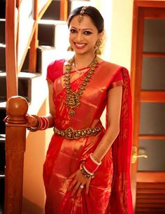 Gorgeous, glowing south Indian bride, Anju, in a red silk saree and traditional jewellery in antique gold. #wedding