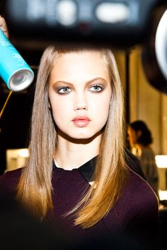 Lindsey Wixson getting touched up before walking for Carolina Herrera at New York's Fashion Week. Photo by Eli Schmidt.