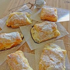 Romanian Farmer Cheese Sweet Pastries are delicious and easy to make. The puff pastry is filled with farmer cheese and raisins and baked to perfection for a lovely dessert or snack. Just Desserts, Dessert Recipes, Keto Desserts, Dessert Ideas, Delicious Desserts, Whole Food Recipes, Cooking Recipes, Easy Cooking, Cheese Pastry