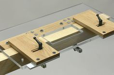 A simple hinge routing plate or mortising jig by Pat Warner. All Pat's jigs are beautifully machined from wood, plexi and aluminum block. Just spectacular accomplishment in the world of jig making.