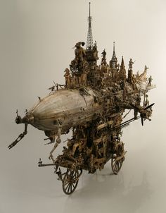 It's like the Steampunk version of the Death Star.  Work by Kris Kuksi