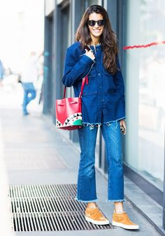 A raw-hem denim jacket is paired with cropped jeans, fringe suede sneakers, round sunglasses, and a bucket bag