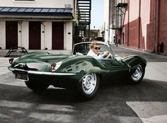 Steve McQueen in his Jaguar 1956 xkss
