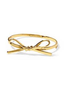 Kate Spade New York Skinny Mini Bow Bangle - Gold by: Kate Spade New York @Piperlime #ring #gold #bow
