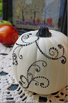Easy no carve pumpkins--paint white, use scrapbooking embellishments and your done.