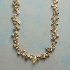 Peach moonstone, opal, and gemstone cluster necklace