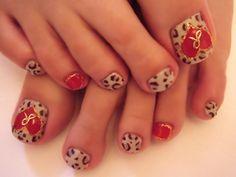 Leopard and red pedi