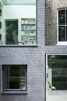 London house extension on Alwyne Place by Lipton Plant Architects, The rear is framed in Staffordshire Slate Blue Smooth brick. the glass roof creates the connection between the upper and ground floor area and serves as a roof terrace. Brick Architecture, Sustainable Architecture, Architecture Details, Interior Architecture, Residential Architecture, Contemporary Architecture, Brick Cladding, Brickwork, Brick Facade