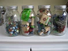 Have collections of small things that need to stay on a shelf (away from babies)?  Organize older kid's collections in ball jars - marbles, rocks, shrinky dinks, automo blox, hex bugs, squinkies, etc.  They look interesting on a book shelf and aren't accessible to tiny hands.