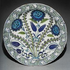 Islamic pottery is actually glass.  Not all of it, of course, but all of the pretty stuff with flowers all over it, like this:    It's made out of fritware, or stonepaste, which is actually white sand mixed with alkaline glaze (sand and plant ash) and clay.  So that would make this plate less than 10% clay.  And basically all glass.