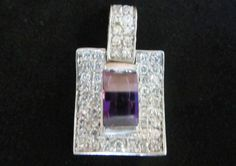 Sterling silver pendant amethyst with white zircons.