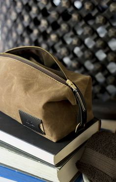 Made of waterproof canvas and premium Horween leather, these low-key yet eye-catching dopp kit cases are designed for the everyday man who wants to look good without coming across like he's trying too hard. Sleek yet masculine, rugged yet elegant, compact yet spacious enough to hold a comb, razor, and anything else you need to get you through the day — all made right here in the USA to guarantee the toughest performance for years on end.