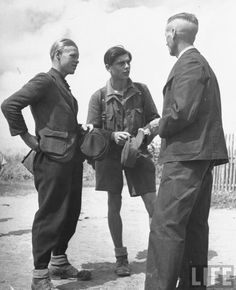 Two ex-Wehrmacht soldiers in search of work speaking to mayor, Germany, 1946