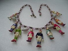 Vintage celluloid Occupied Japan football necklace by ThePlasticFever, $120.00 Etsy.