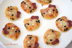 Hello Kitty Pizza Bites. *Olives for eyes and whiskers, Pepperoni Bow, and a cheeseball nose perhaps?