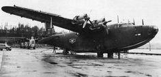 Captured Kawanishi H8K2 flying boat in 1945, US Navy PBM Mariners behind. Oak Harbor, Washington.(Source)