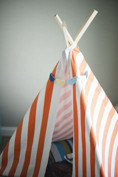 DIY tepee for a todders playroom, orange and white stripes